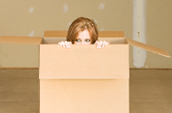 Girl inside cardboard box cropped