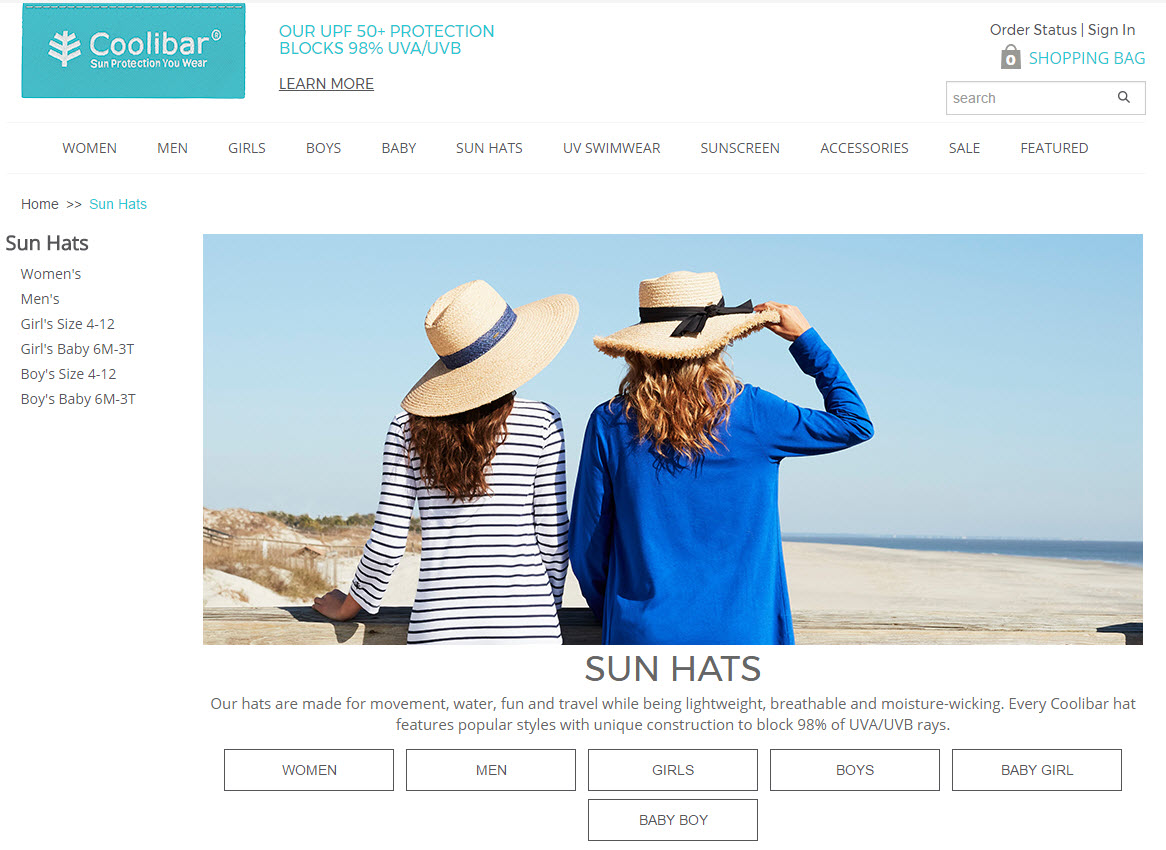 Image of two women wearing sunhats on a beach.
