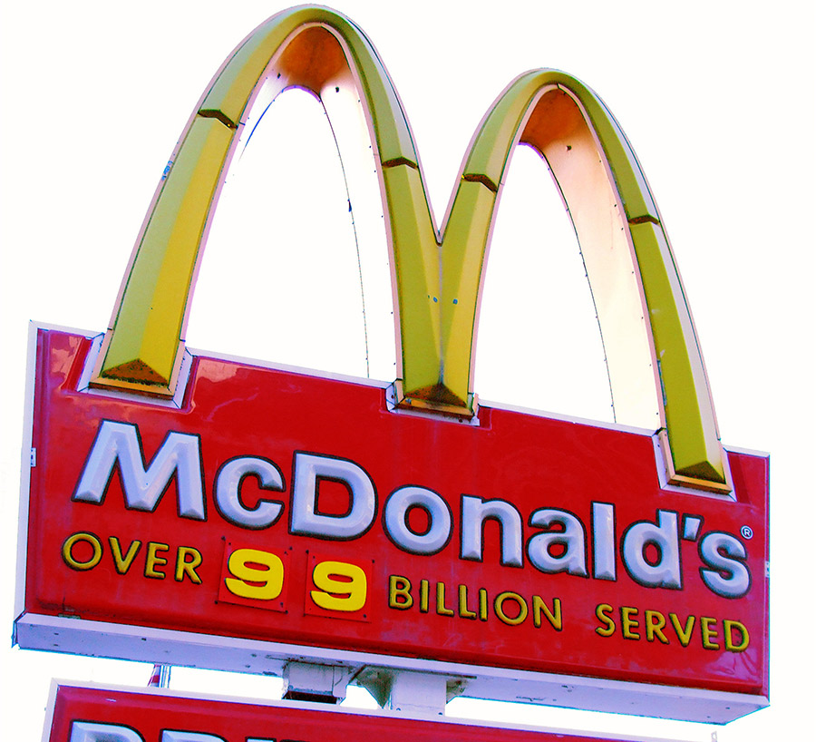 McDonald's signage about the number of billion served is social proof.