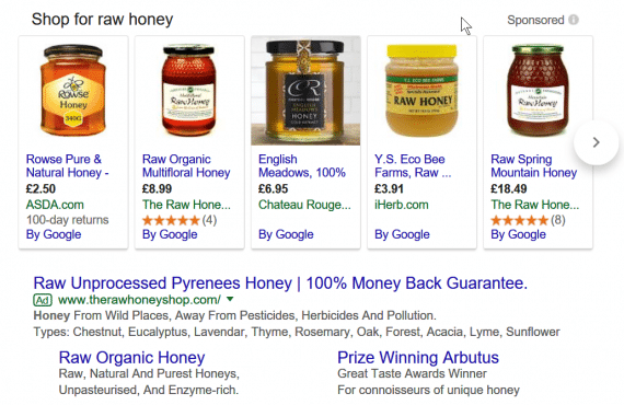 "In this example from Google search results, The Raw Honey Shop has two Shopping ads (""Raw Organic Multifloral Honey"" and ""Raw Spring Mountain Honey"") as well as a text ad."