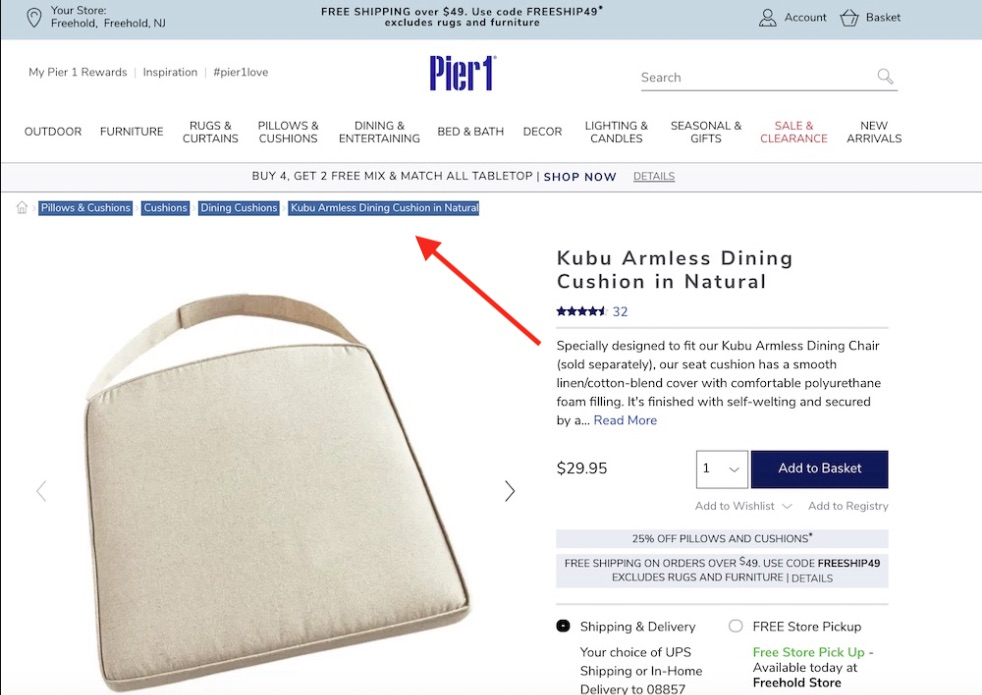 """Locate a product page on Pier 1, such as """"Kubu Armless Dining Cushion in Natural,"""" and visually check for the breadcrumbs."""