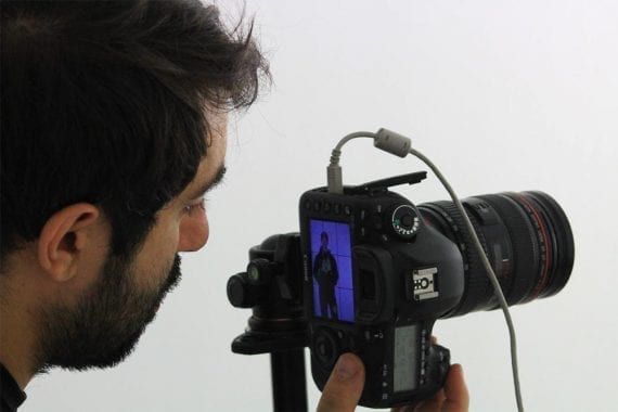 A man shoots a video with a DSLR camera. <em>Photo: Stefano Intintoli.</em>