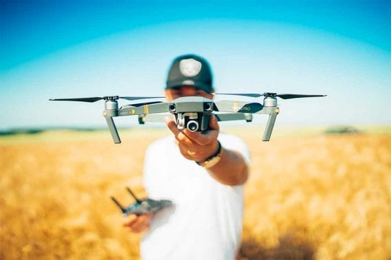 Image of a man holding a drone