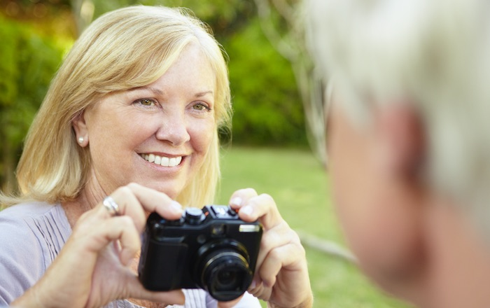 Photo of middle-aged lady holding a camera