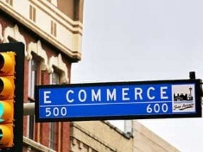 """Photo of a street sign reading """"E Commerce."""""""