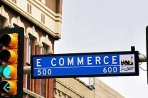 "Photo of a street sign reading ""E Commerce."""