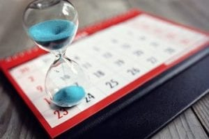 Photo of a calendar with an hour glass