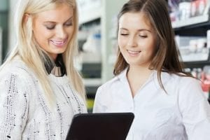 Image of a in-store associate with a customer