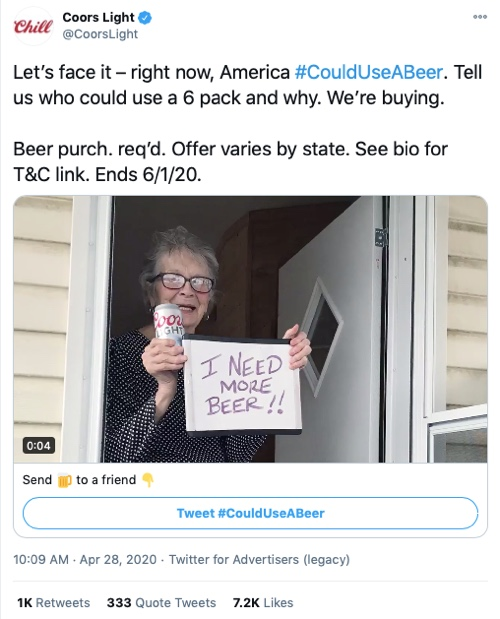 "Image of a lady in a doorstep holding a ""I Need More Beer!"" sign"