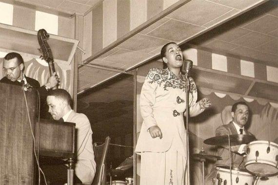 Photo of Billie Holiday singing.