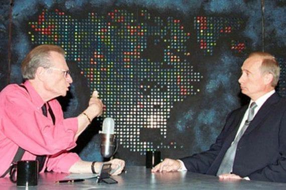 Photo of Larry King interviewing Vladimir Putin