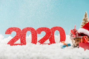 "Illustration of a Christmas wreath with the letters ""2020"""