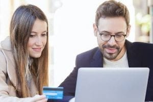 Photo of a female and buy shopping on a laptop