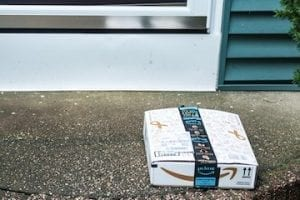 Photo of an Amazon package on a front porch
