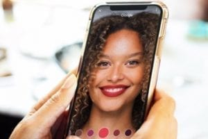 Mobile phone with virtual makeup on the screen