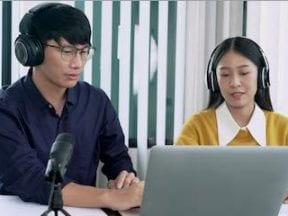 Image of a male and female in a podcast interview