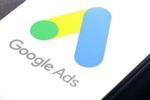 Image of an mobile phone with Google Ads logo on the screen