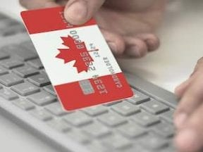 Screenshot of a Canada credit card over a keyboard