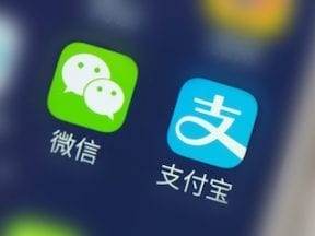 Mobile phone screen with WeChat and Alipay apps