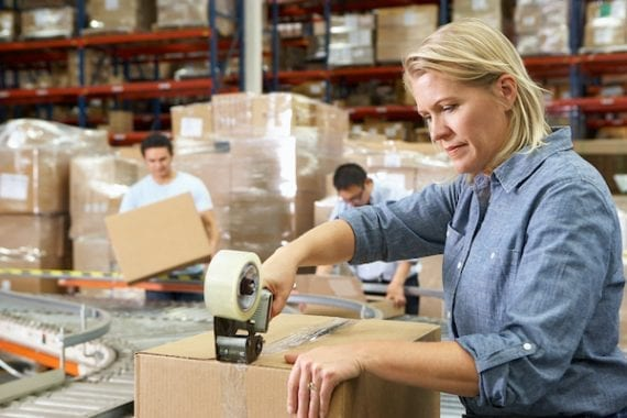 Photo of workers in a fulfillment warehouse