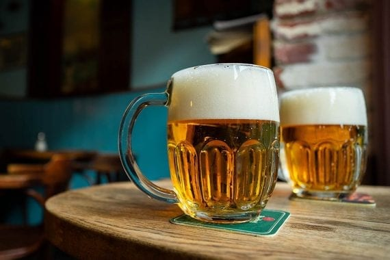 Photo of two pints of beer on a table