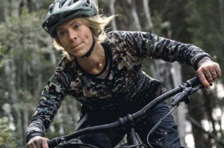 Image from Erik's home page of a lady riding a mountain bike