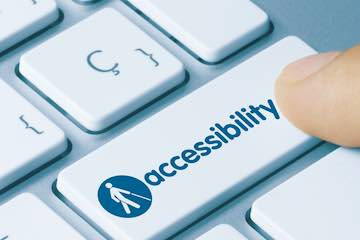 "Image of a keyboard key that reads ""accessibility"""