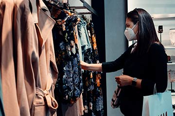 Photo of a female shopping for clothes at a physical store