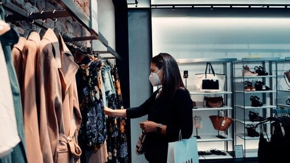 Photo of a female shopping for clothing in a physical store