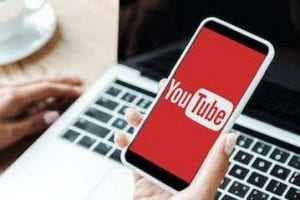 Image of a smartphone with YouTube logo on the screen