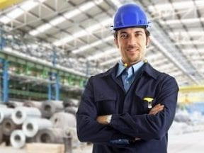 Photo of a male standing in a factory