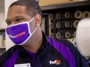 Screenshot from HappyReturns.com showing a FedEx exmployee recieving a returned item