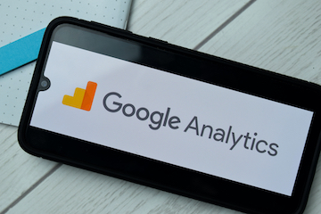 Image of a smartphone with a Google Analytics logo on the screen
