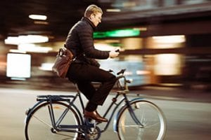 Man riding a bike in an urban setting