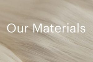 """Screenshot from Everlane's website with text """"Our Materials"""" behind an image of cotton"""