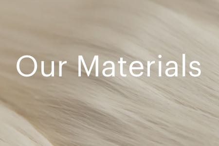 "Screenshot from Everlane's website with text ""Our Materials"" behind an image of cotton"