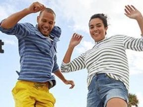 Screenshot from Eddie Bauer email showing a male and female smiling