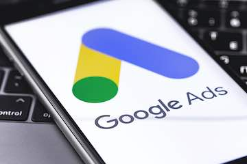 Photo of a smartphone with Google Ads logo on the screen