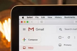 Image of a smartphone screen with a prominent Gmail icon