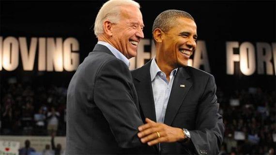 Photo of Joe Biden and Barack Obama laughing.