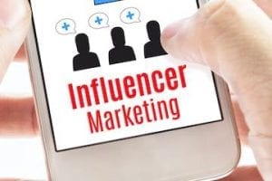 """Image of a smartphone screen showing the text """"Influencer marketing"""""""