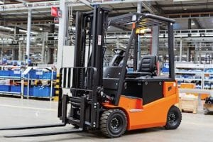 Photo of a forklift in a warehouse