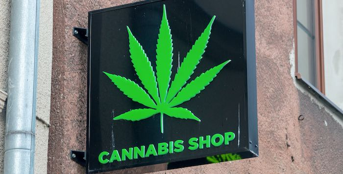 """Photo of a retail sign stating """"Cannabis Shop"""""""