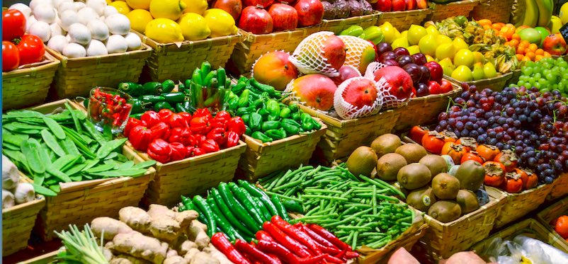 Photo of fresh fruits and vegetables in a store.