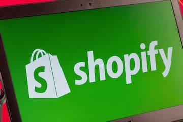 Photo of a laptop computer with the Shopify logo on the screen