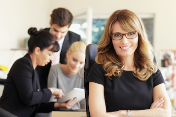 Photo of a female with staff in a business setting