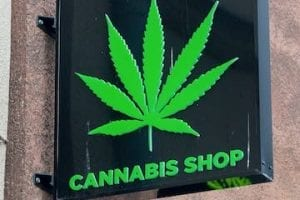 """Photo of a retail sign reading """"Cannabis Shop"""""""