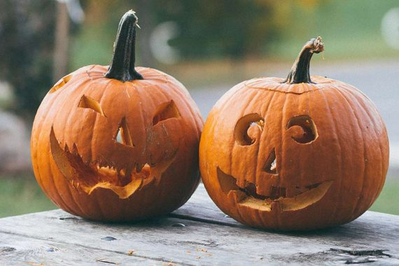 Photo of two pumpkins carved with faces for Halloween