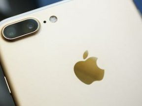 Photo of the back of an iPhone with the Apple logo visible