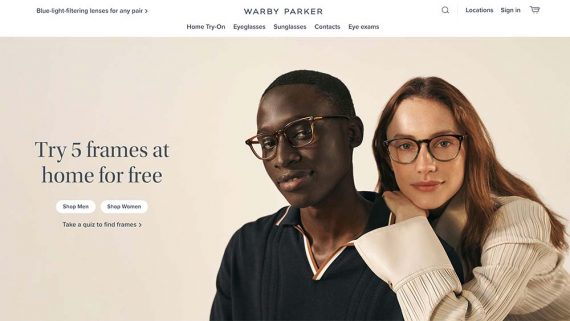 Warby Parker home page showing a male and female wearing eyeglasses